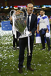 Real Madrid Manager Zinedine Zidane celebrates with the trophy after the UEFA Champions League Final match between Juventus and Real Madrid at the Principality Stadium on June 3rd 2017 in Cardiff, Wales.