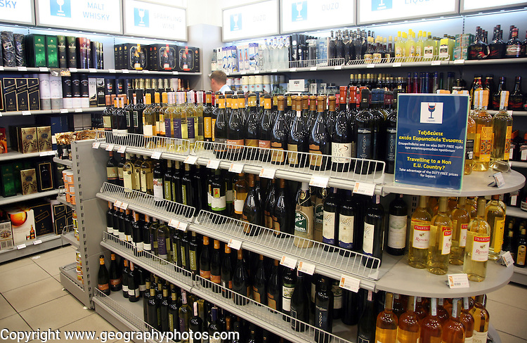 Airport duty free shop with bottles of alcohol, Rhodes, Greece