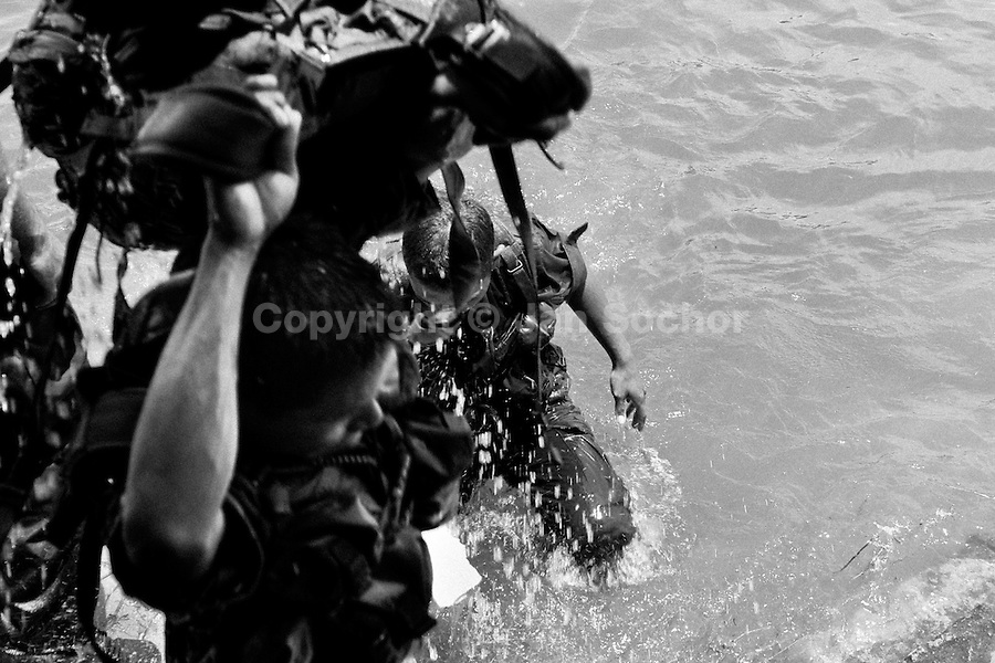 A young Colombian Police recruit with military kit bag during the training for combat operation, 23 September 2006, Meta Department, ..Colombia.