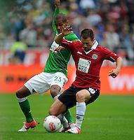 FUSSBALL   1. BUNDESLIGA   SAISON 2012/2013   3. SPIELTAG Hannover 96 - SV Werder Bremen     15.09.2012 Theodor Gerbe Selassie (li, SV Werder Bremen) gegen Szabolcs Huszti (re, Hannover 96)