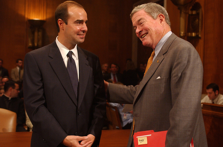 1Scalia100201 -- At left, Eugene Scalia, nominee for Solicitor of Labor, gets encouragement from Sen. Kit Bond, R-Mo., before Scalia's conformation hearing.