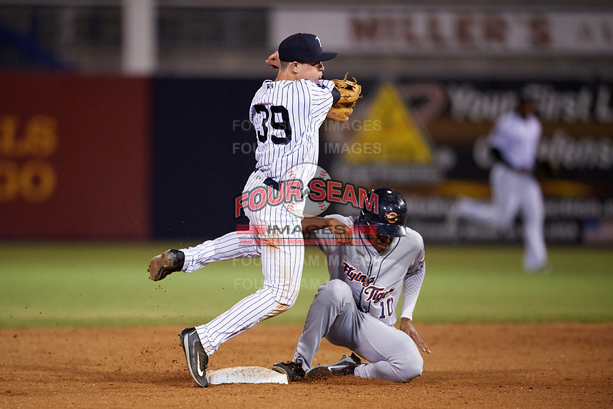 Tampa Yankees second baseman Nick Solak (39) throws to first base as Jose Azocar (10) slides in to second during a game against the Lakeland Flying Tigers on April 7, 2017 at George M. Steinbrenner Field in Tampa, Florida.  Lakeland defeated Tampa 5-0.  (Mike Janes/Four Seam Images)