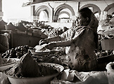 ERITREA, Asmara, a woman vendor sells flour at an open air market in Asmara (B&W)