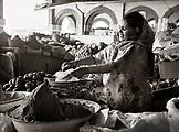 ERITREA, Asmara, a woman vendor sells flour at an open air market in Asmara (B&W)