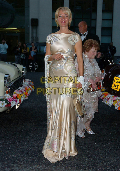 EMMA THOMPSON.Glamour magazine's 3rd Annual Woman of the Year Awards Berkeley Square Gardens - Arrivals, London, UK. .June 6th, 2006 .Ref: CAN.full length satin cream gold floral print dress.www.capitalpictures.com.sales@capitalpictures.com.©Capital Pictures