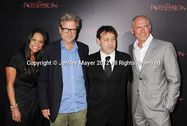 HOLLYWOOD, CA - AUGUST 28: Nicole Brown, Ole Bornedal, Sam Raimi and Joe Drake arrive at the 'The Possession' - Los Angeles Premiere at ArcLight Cinemas on August 28, 2012 in Hollywood, California.