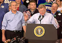 Montana senator Conrad Burns introduces President George W. Bush at a campaign rally for the senator at MetraPark in Billings, Mont., Nov. 2, 2006. Burns lost the election to Jon Tester.