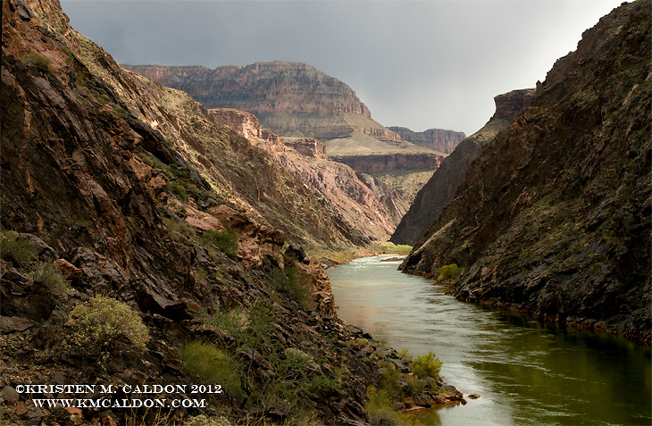 Patchy light illuminates Crystal Rapid and the inner gorge of Grand Canyon.