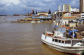 Belem, Para State, Brazil; riverboats at the dock with the Ver-O-Peso market behind.