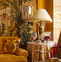 The golden theme of the drawing room has been achieved by creating layers of colour, pattern and texture