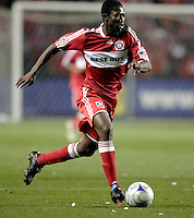 Chicago Fire forward Patrick Nyarko (14) dribbles the ball down the field.  Real Salt Lake defeated the Chicago Fire in a penalty kick shootout 0-0 (5-4 PK) in the Eastern Conference Final at Toyota Park in Bridgeview, IL on November 14, 2009.