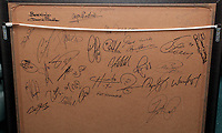 Pictured: Signatures at the back of a commemorative frame showing the players boarding the tragic Munich air disaster aeroplane. Monday 14 November 2011<br /> Re: 72 year old Kenny Morgans (correct) who signed for Manchester United on leaving school in the summer of 1955 <br /> He suffered minor injuries in the Munich air disaster, when still only 18 years old and was found unconscious amongst the debris by two journalists five hours after the official search was called off.<br /> He made a full recovery following the crash but never regained his form on the pitch and later played in the lower divisions for Swansea Town and Newport County before retiring from football in 1967.