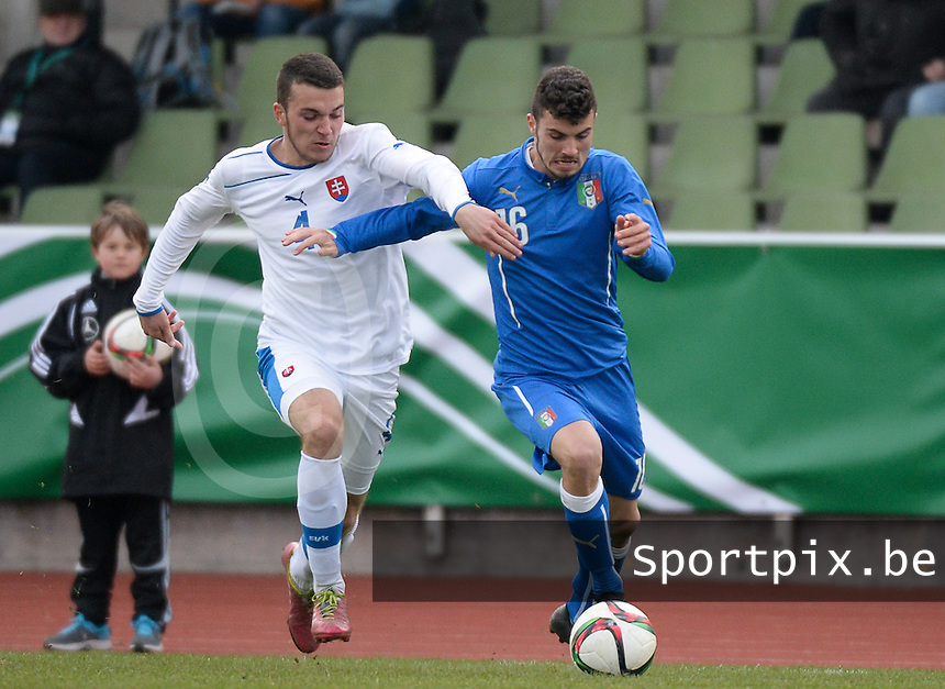 20150323 - MARBURG , GERMANY  : duel pictured between Italian Patrick Cutrone (right) and Slovakian Andrej Strba (left) during the soccer match between Under 17 teams of Slovakia and Italy , on the second matchday in group 8 of the UEFA Elite Round Under 17 at Georg-Gassmann , Marburg Germany . Monday 23 rd  March 2015 . PHOTO DAVID CATRY