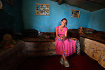 "THIS PHOTO IS AVAILABLE AS A PRINT OR FOR PERSONAL USE. CLICK ON ""ADD TO CART"" TO SEE PRICING OPTIONS.   A young woman in her one-room house in a largely Roma, Turkish-speaking neighborhood of Dobrich, in the northeast of Bulgaria."