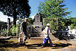 A couple walks past the grave of Japan's war-time prime minister, Hideki Tojo, at a cemetery in Tokyo on Saturday 15 Aug. 2009. Aug. 15 marks the 64th anniversary of Japan's surrender in the Pacific War. Tojo, who gave the command to bomb Pearl Habour, was convicted as a Class A war criminal.