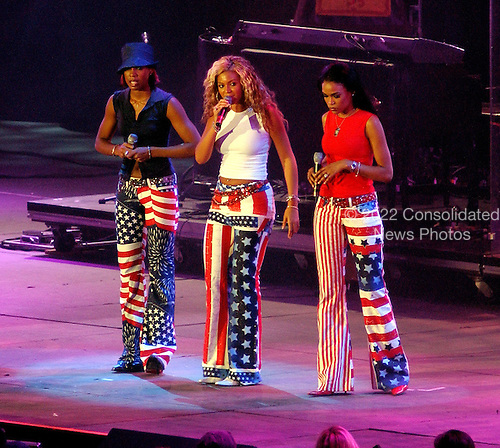"Destiny's Child performs at  RFK Stadium in Washington, DC for the ""United We Stand"" Concert on October 21, 2001.  From left to right: Kelly Rowland, Beyoncé Knowles, Michelle Williams..Credit: Ron Sachs / CNP"
