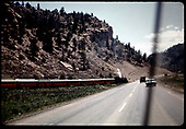 D&amp;RGW #483 K-36 (RMRRC excursion Durango - Chama) crossing highway.<br /> D&amp;RGW  between Durango &amp; Chama, NM  5/30/1966