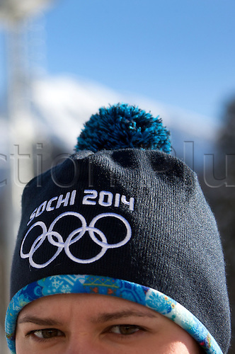 18.12.2013 Sochi, Russia. A woman wears a Sochi 2014 hat with the Olympic Rings at the Laura Biathlon & Ski Complex in Krasnaya Polyana, Russia. Sochi will host the Winter Olympic Games from 07 to 23 February 2014.