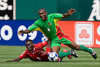 05 July 2009: Jose Luis Garces of the Panama fights for the ball against Cedric Avinel of the Guadeloupe during the first half of the game at Oakland-Alameda County Coliseum in Oakland, California.   Guadeloupe defeated Panama, 2-0.