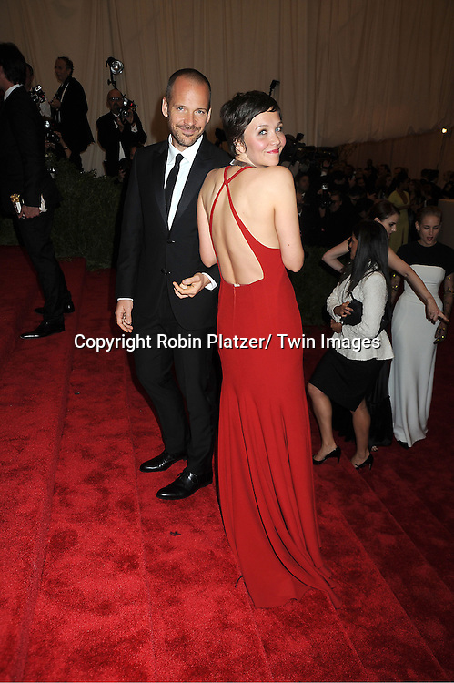 Maggie Gyllenhaal and Peter Sarsgaard  attends  the Metropolitan Museum of Art Costume Institute Beneift celebrating the opening of  PUNK: Chaos .to Couture on May 6, 2013 in New York City.
