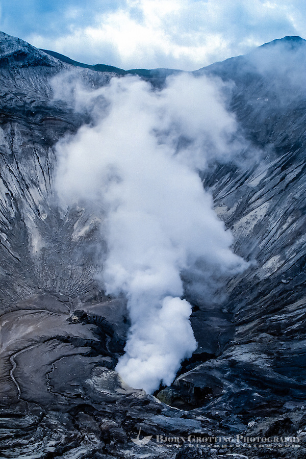 Java, East Java, Mount Bromo. Looking down in the smoking crater.