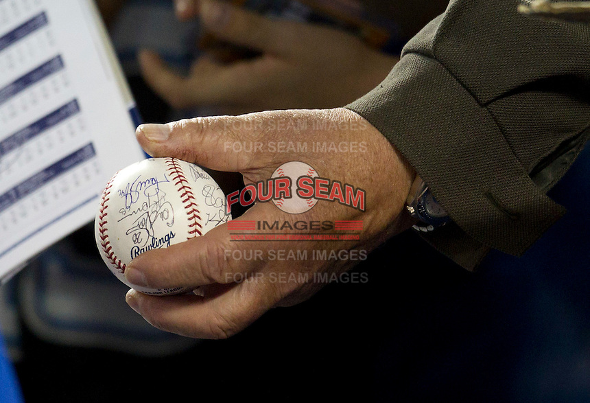 Toronto Blue Jays fan asking for autographs on a ball during batting practice before a game against the Boston Red Sox at Rogers Centre on June 3, 2012 in Toronto, Ontario.  (Mike Janes/Four Seam Images)