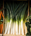 Fresh leeks in wooden crate box