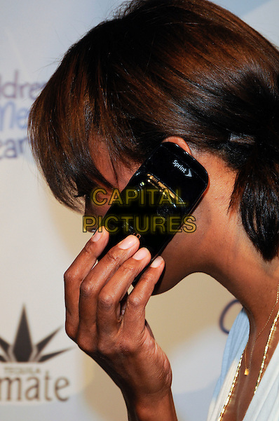 "AISHA TYLER.arriving at Children Mending Hearts' 3rd Annual ""Peace Please"" Gala at the Music Box @ Fonda in Hollywood, California, USA, April 16th, 2010.  .arrivals portrait headshot side profile hand talking on phone mobile cell .CAP/ROT.©Lee Roth/Capital Pictures"