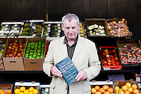 26/8/2011. Dublin Fruit and Vegetable Market.  Derek Leonard holds his Quran, 5th generation seller from Leonard Potatoes is pictured at the Dublin Fruit and Vegetable Market. for over 40 years. Picture James Horan/Collins Photos