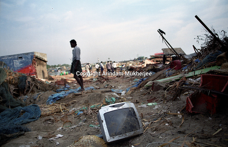 A man assesses the devastation of his home.Akkaraipettai, Nagapattinam.India.
