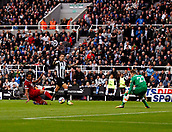 1st October 2017, St James Park, Newcastle upon Tyne, England; EPL Premier League football, Newcastle United versus Liverpool; Joselu of Newcastle United slips the ball past Simon Mignolet of Liverpool to equalise in the 36th minute in the 1-1 draw