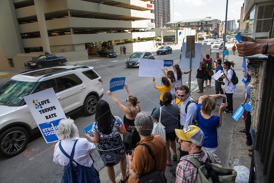 Austin, Texas - Tues., August 23, 2016 - Protesters on Lavaca Street hold up signs against Republican presidential candidate Donald Trump as cars pass by during rush hour while Trump makes an appearance at a taping of a two-hour interview with Fox News host Sean Hannity at ACL Live at The Moody Theater in downtown Austin, Texas.<br />