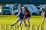 Padraig Griffin, Kerin's O'Rahilly's looks around before turning with Karl Mullins of Dr Crokes keeping goal side of him, when the sides met in Tralee last Saturday evening.