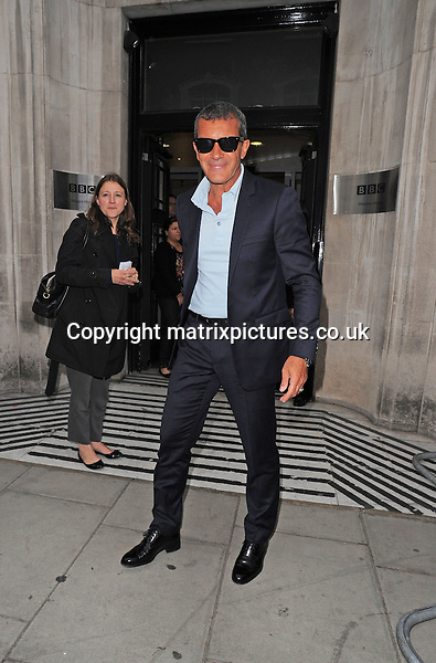 NON EXCLUSIVE PICTURE: PALACE LEE / MATRIXPICTURES.CO.UK<br /> PLEASE CREDIT ALL USES<br /> <br /> WORLD RIGHTS<br /> <br /> Spanish actor Antonio Banderas is pictured looking sharp in a tailored blue suite, black boots and black Ray Ban Wayfarer shades as he arrives to the BBC Studios in Central London.<br /> <br /> SEPTEMBER 7th 2013<br /> <br /> REF: LTN 135937