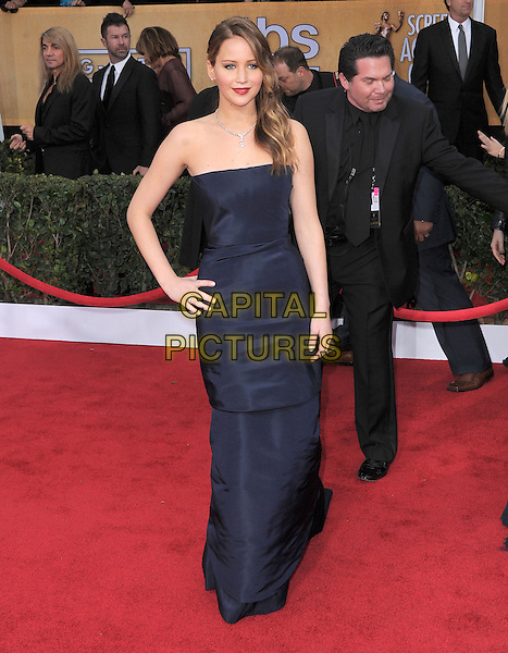 Jennifer Lawrence (wearing Christian Dior).Arrivals at the 19th Annual Screen Actors Guild Awards at the Shrine Auditorium in Los Angeles, California, USA..27th January 2013.SAG SAGs full length strapless dress blue hand on hip navy.CAP/DVS.©DVS/Capital Pictures.