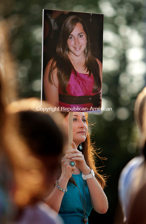 WATERBURY, CT-21 June 2013-062113BF01- Lucy Palmucci from Orange holds a portrait of her niece Emily Gomes, 17, during graduation at Cheshire High School Friday in Cheshire. Bob Falcetti Republican-American