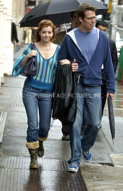 WWW.ACEPIXS.COM ** ** **EXCLUSIVE!!! FEE MUST BE NEGOTIATED BEFORE USE!!!***....NEW YORK, SEPTEMBER 29, 2005....Alyson Hannigan and Alexis Denisof take a wet, windy day to stroll SoHo.....Please byline: Philip Vaughan -- ACE PICTURES... *** ***  ..Ace Pictures, Inc:  ..Craig Ashby (212) 243-8787..e-mail: picturedesk@acepixs.com..web: http://www.acepixs.com