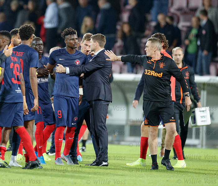 08.08.2019 FC Midtjylland v Rangers: Steven Gerrard separates Sory Kaba and Tom Culshaw at full time
