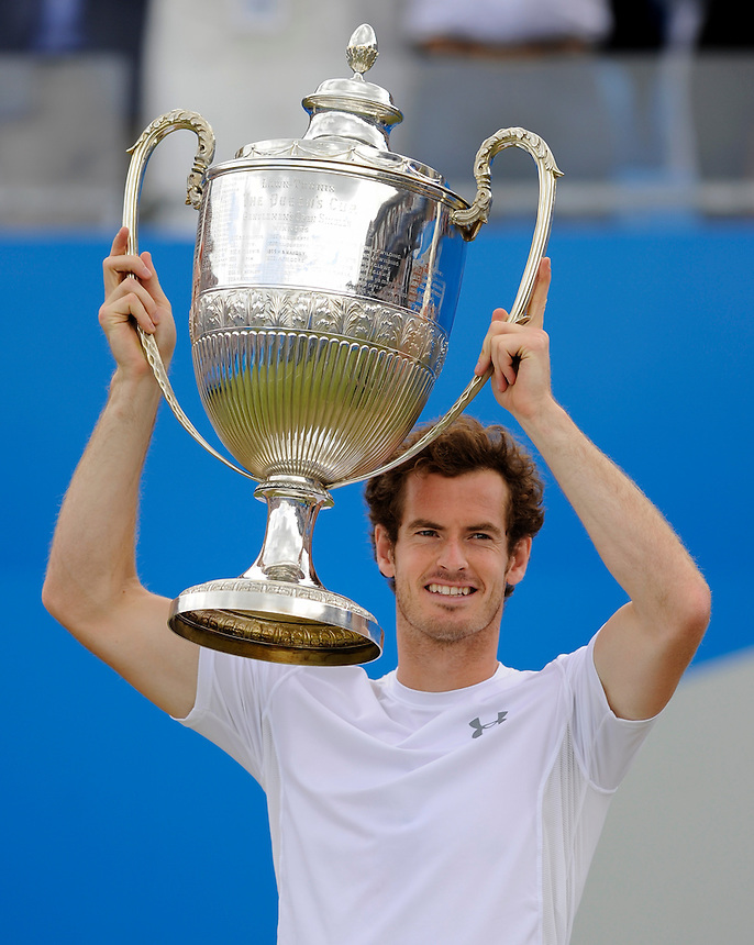 Andy Murray (GBR) lifts the trophy after his victory over Kevin Anderson (RSA) in their Men&rsquo;s Singles Final match - Andy Murray (GBR) def Kevin Anderson (RSA) 6-3, 6-4<br /> <br /> Photographer Ashley Western/CameraSport<br /> <br /> Tennis - ATP 500 World Tour - AEGON Championships- Day 7 - Sunday 21st June 2015 - Queen's Club - London <br /> <br /> &copy; CameraSport - 43 Linden Ave. Countesthorpe. Leicester. England. LE8 5PG - Tel: +44 (0) 116 277 4147 - admin@camerasport.com - www.camerasport.com
