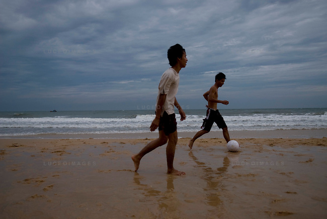 Mui Ne locals play soccer on the beach.