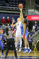 SEATTLE, WA - DECEMBER 18: Washington's Katie Collier against Savannah State Tiyonda Davis.  Washington won 87-36 over Savannah State at Alaska Airlines Arena in Seattle, WA.