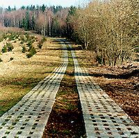 Former east German patrol road in the Harz mountains at the former border between East and West Germany.  The Cold War, which formed part of the collective consciousness of post war Europe from 1945 until 1989 dominated the military and political landscape.  Often highly charged with nationalistic zeal, Soviet rhetoric and paranoia, relics of the Cold War remain as testaments to the covert era within Eastern Europe. CHECK with MRM/FNA