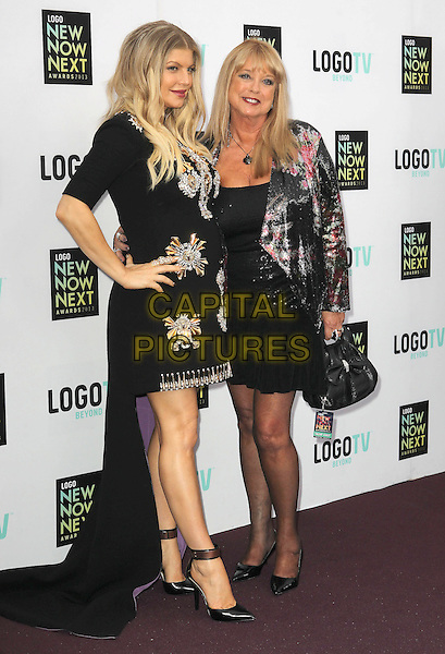 Fergie (Stacy Ferguson) of Black Eyed Peas & Terri Gore.2013 NewNowNext Awards held at The Fonda Theatre, Los Angeles, California, USA, 13th April 2013..full length black dress pregnant embellished beaded train ankle strap shoes gold trim clutch bag maternity purple hand on hip jacket bag .CAP/ADM/KB.©Kevan Brooks/AdMedia/Capital Pictures