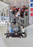 9 January 2016: United Kingdom pilot Lamin Deen leads his 4-man team as they cross the finish line after their second run of the day at the BMW IBSF World Cup Bobsled Championships at the Olympic Sports Track in Lake Placid, New York, USA. Deen's team came in 4th for the day, with a 2-run combined time of 1:50.11. Mandatory Credit: Ed Wolfstein Photo *** RAW (NEF) Image File Available ***