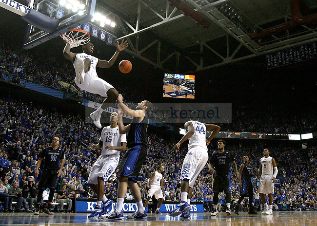UK junior forward Alex Poythress (22) dunks the ball during the second half of the University of Kentucky vs. State University of New York at Buffalo men's basketball game at Rupp Arena in Lexington, Ky., on Sunday, November 16, 2014. UK won 71-52. Photo by Tessa Lighty | Staff