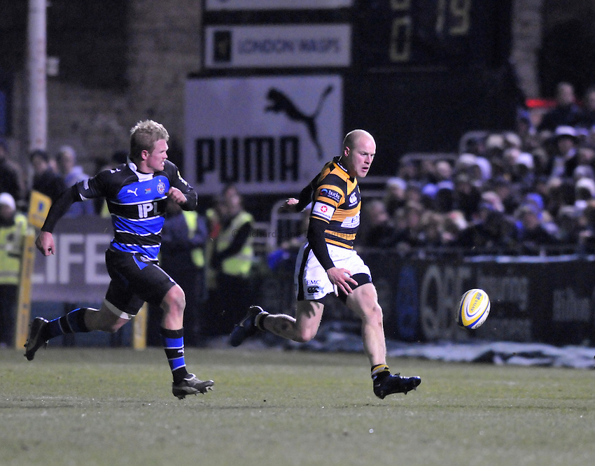 Photo: Tony Oudot/Richard Lane Photography. Bath Rugby v London Wasps. Aviva Premiership. 27/11/2010. .Joe Simpson of Wasps chases the ball with Michael Claassens of Bath.