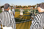Manhattan Beach, CA 05/12/09 - Head Referee Tim Rossi explains the expectations and rules of conduct to the Mira Costa and Loyola Captains before the coin toss.