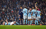 Dele Alli of Tottenham Hotspur gets a yellow card from Referee Craig Pawson after the challenge on Kevin De Bruyne of Manchester City during the premier league match at the Etihad Stadium, Manchester. Picture date 16th December 2017. Picture credit should read: Robin ParkerSportimage