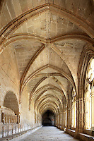 Low angle view of a groin vaulted gallery in the cloister of the Monestir de Santes Creus, Aiguamurcia, Catalonia, Spain, pictured on may 21, 2006, in the morning. Beautiful noblemen's tombs are set in the wall of the gallery on the left of the picture. The Cistercian Reial Monestir Santa Maria de Santes Creus and its church were built between 1174 and 1225. Following strict Cistercian rule, the Romanesque complex originally featured no architectural embellishments with the exception of ornamented capitals and crenellations on the rooflines. In the 13th century parts of the abbey and the cloister were converted in Gothic style by James II of Aragon who also added the dome to the church. Picture by Manuel Cohen.
