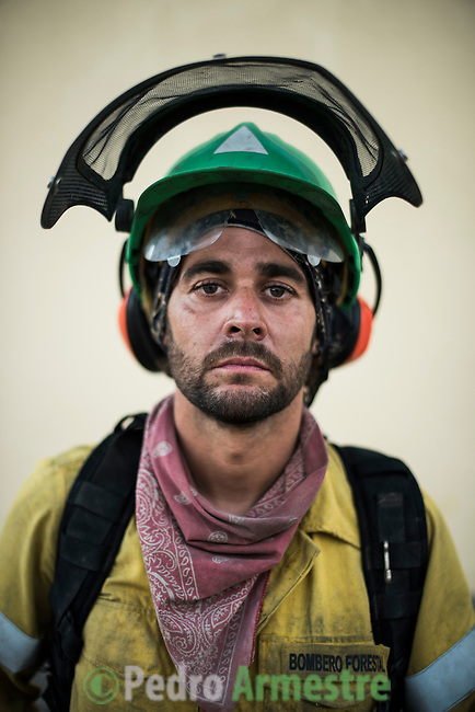 Francisco Perez Sanchez (Alora, M&aacute;laga) 35 years. Chainsaw.<br /> The firefighter from the BRICA M&aacute;laga 703, the Andalusian Service firefighting (INFOCA),  posses after a wildfire in Los Barrios near Cadiz on July 25, 2015. &copy; Pedro ARMESTRE